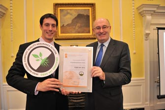 Kevin McCabe, Facility Operations Manager,is presented an award from Minister Phil Hogan. Enrich becomes one of the first composting facility to be awarded with the new compost quality standard.